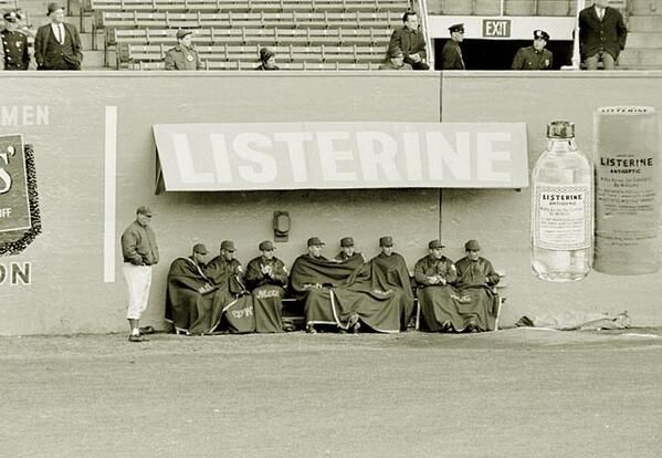 The bullpen at the Polo Grounds, 1962. Not very much shelter for the New York Mets bullpen.