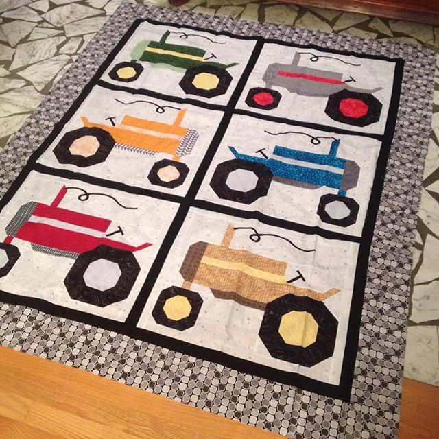 Love how my #farmgirltractorblock #farmgirlvintage quilt turned out, even if Brent says I was wrong to mix my tractor colors.
