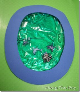 We made an O is for Ocean.   To make it we filled a Ziploc bag with Corn Syrup and blue food coloring and added some sea animal buttons that I found at Michael's.  I taped it to the back of the letter O and let Aiden have fun squishing the bag.