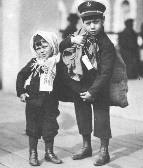 Ellis Island. Immigrant children wearing arrival tags.