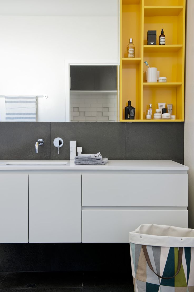 Love the yellow cabinet and fitted mirror. White, slate and yellow bathroom