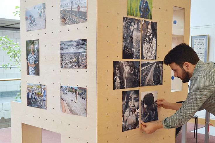 Cesare Moreno curating his photographic art display