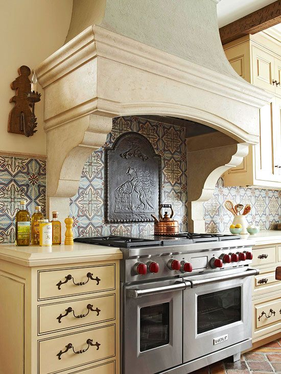 Depth & Dimension. Use depth to add dimension to your backsplash. This distinctive cast-iron fireback creates a focal point that contrasts with the colorful patterned tiles, creating a noticeable relief effect.