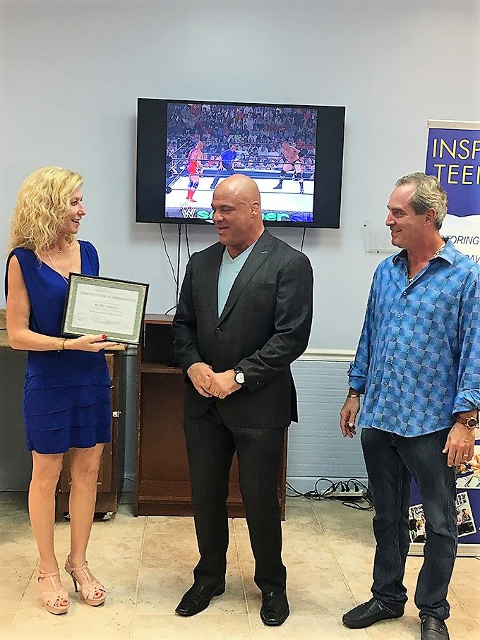 Karen Corcoran Walsh and Chris Walsh owners of @IYFTeenrehab present #wwe champion @kurtangle #kurtangle with an award. Read more at