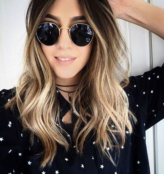 Layers on mid length hairs With Balayage Ombre Highlights
