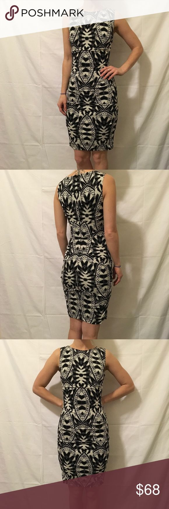 "Nicole Miller Printed Ruched Printed Bodycon Dress Nicole Miller Artelier Black and White Printed dress with a Bodycon fit and is form fitting. Zipper closure in back and is in great condition worn only once! Marked a ""p"" but fits like a 2! Nicole Miller Dresses Midi"
