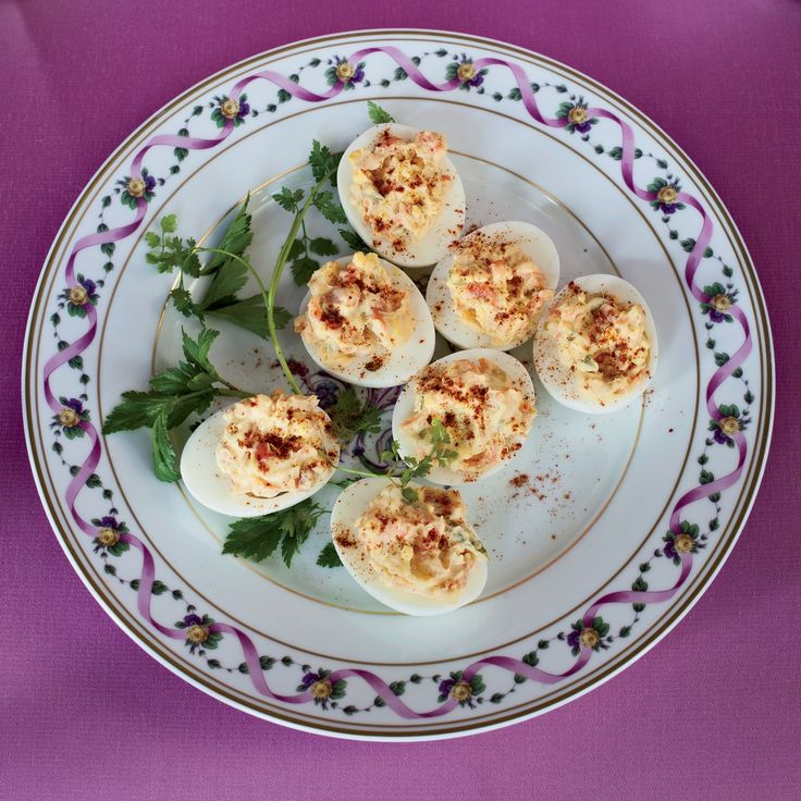 Chef Michael Mina turns deviled eggs into elegant party hors d'oeuvres by adding chopped smoked salmon.