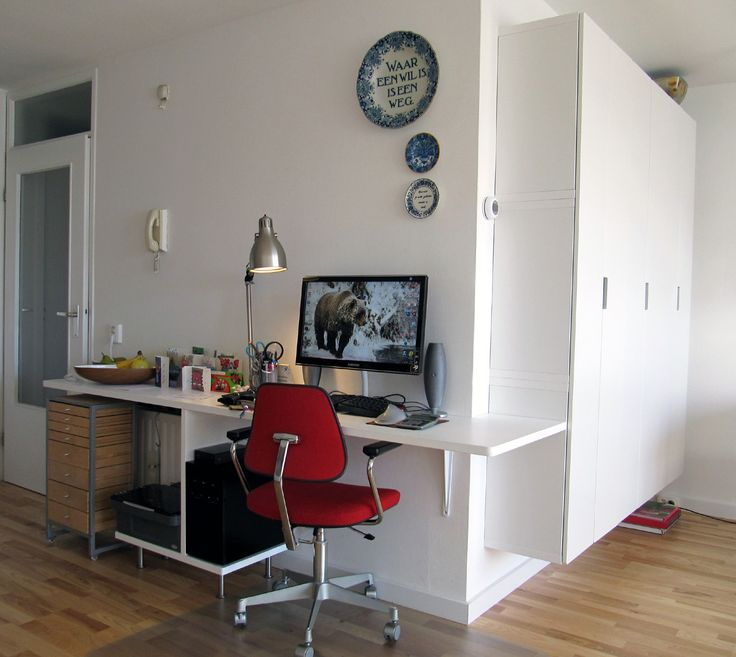 Wrapped around the corner of 2 walls a PC work space and (modified) ikea stuva wall unit for books and administration and a vintage stal and stil chair