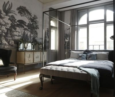 Krudy Luxury Apartment Budapest - King size bed. A small terrace opens from the upper left corner of the room to Krudy street.