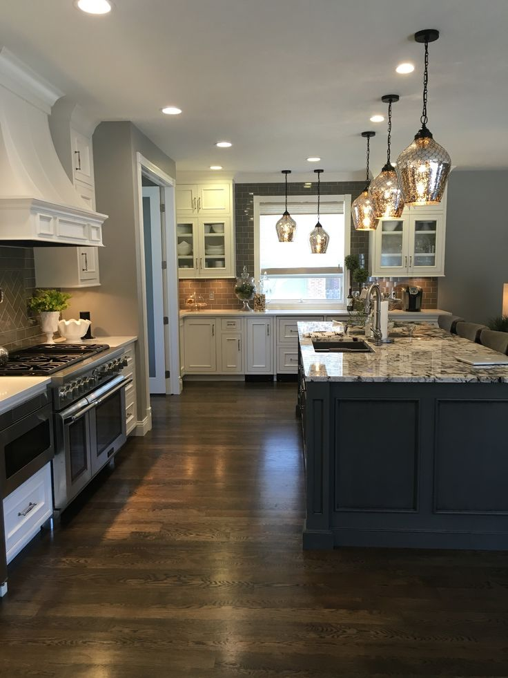 White Cabinets, Granite Island, dark wood floor, gray
