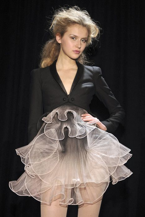 Cropped tuxedo jacket and a surprise of soft wispy ruffles; layered organza dress; tailored fashion details // Marchesa