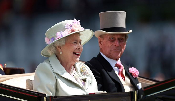 Will one be a winner? The Queen laughs out loud as she is driven up the Royal Ascot racecourse 18th June 2014