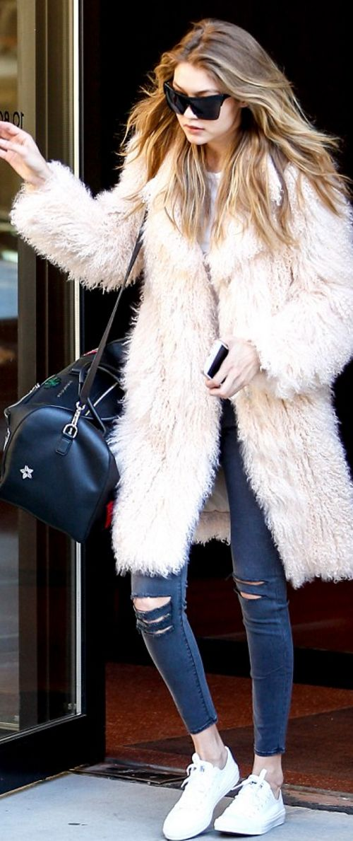 Who made Gigi Hadid's black sunglasses, coat, handbag, and white sneakers?