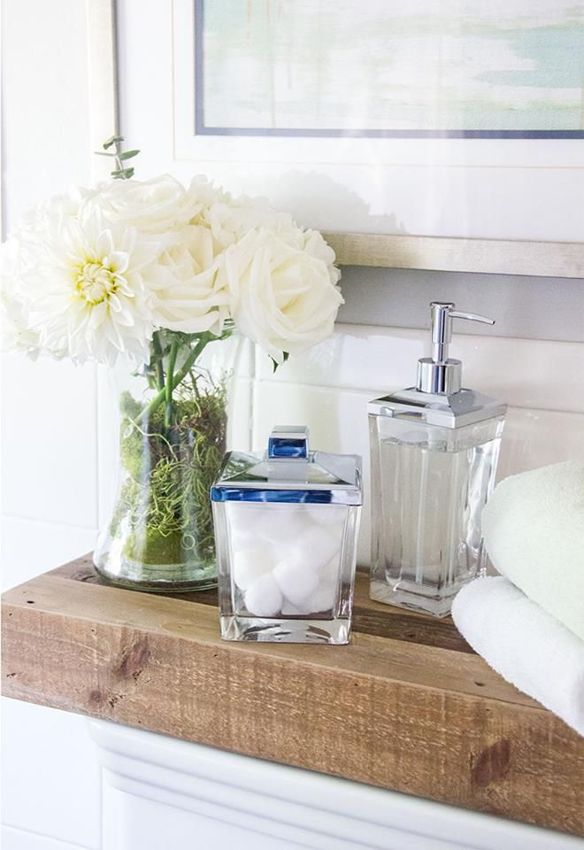 A touch of glass bathroom d cor that keeps things tidy for Bathroom decor vases