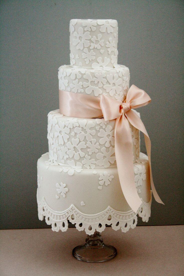 https://flic.kr/p/dVeQAw   Lace fringe wedding cake   Off white wedding cake with white lace detailing and pale peach ribbon x