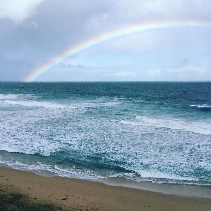I love that no matter rain/shine or both like today..being at the beach is always so beautiful and rejuvenating. Quick break between appointments for a dip of the toes to recharge and appreciate this incredible rainbow. #myhappyplace #warrnambool #logansbeach #worktrip #rainbow by choooka