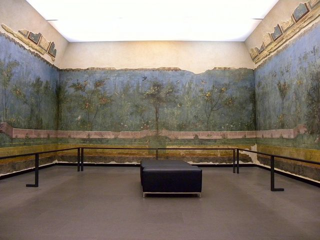 """Ancient Rome - One half of the frescoed triclinium from the House of Livia, Rome. Note how from a sitting height the fence in the frescoes appears to continue in a straight line beyond the walls of the room. Such dramatic trompe l'oeil techniques were typical of frescoes in the """"Second Style"""" known from Pompeii. The room is now reconstructed in the National Museum of Rome, Palazzo Massimo. 30-20 BC."""