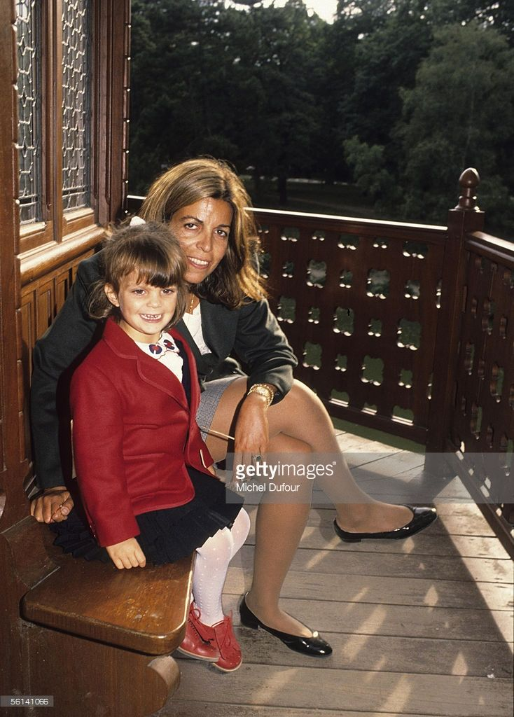 Christina Onassis, daughter of Greek shipping magnet Aristotle Onassis, is seen with her daughter, Athina, at the Bois de Boulogne in Paris, France.