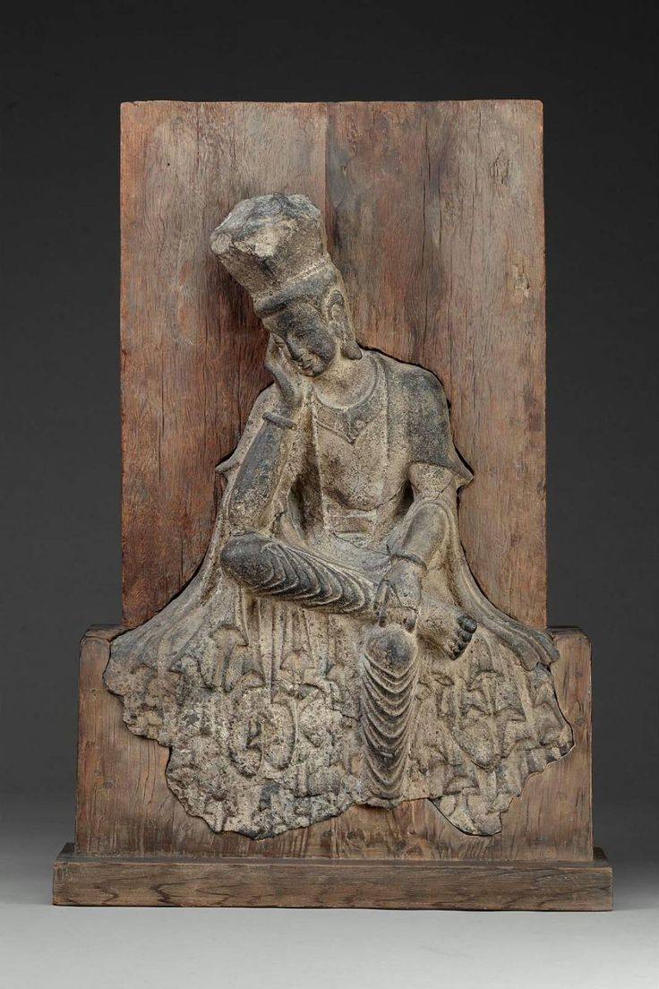 Buddhist figure seated in Pensive Pose.      Chinese;, Northern Wei dynasty, early 6th century A.D.