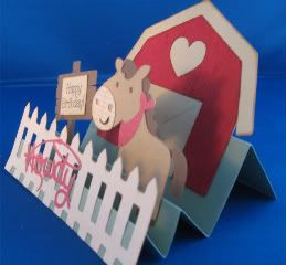 "Score the paper at 1"", 2"", 2"", 4.25"" & 6.25"". The red part of the barn is embossed and all the pieces are inked on the edges. ""Create a Critter"", ""Camp Out"", & ""My World"" cartridges (""Create a Critter"" - horse @ 3"", Howdy @ 1 1/2"", barn @ 4"" / ""Camp Out"" - sign @ 3"" / ""My World"" - fence @ 2"") - Card size - 5.5"" x 5"" - Stamp: ""Happy Birthday"" by My Sentiments Exactly"