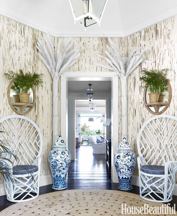 Painted metal palms add whimsy to the foyer in Amanda Lindroth's Bahamas house. Chippendale fan chairs, Circa Who. Mirrors, the Raj Company. Ginger jars, Two's Company. Jute rug, Serena & Lily.   - HouseBeautiful.com