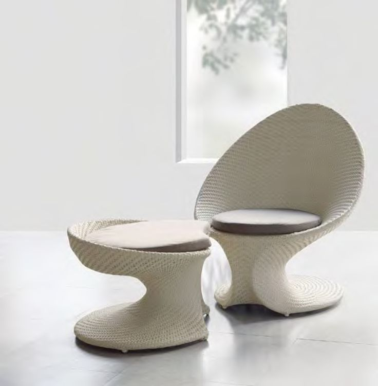 This unique chair and foot stool design begs you to sit back, relax, and enjoy its comfort. The experience is a percent fusion of comfort and style - See more at: http://bit.ly/PPiX8g