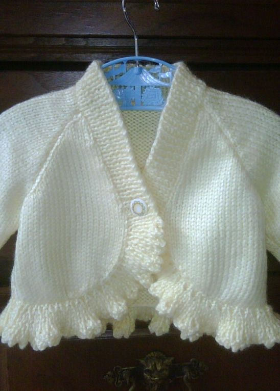 Baby sweater - see pattern source here:  http://www.ravelry.com/patterns/library/bolero-with-v--or-shawl-neck