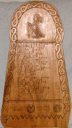 Now that's a heck of a peerage scroll - carved wooden runestone for a Viking persona.