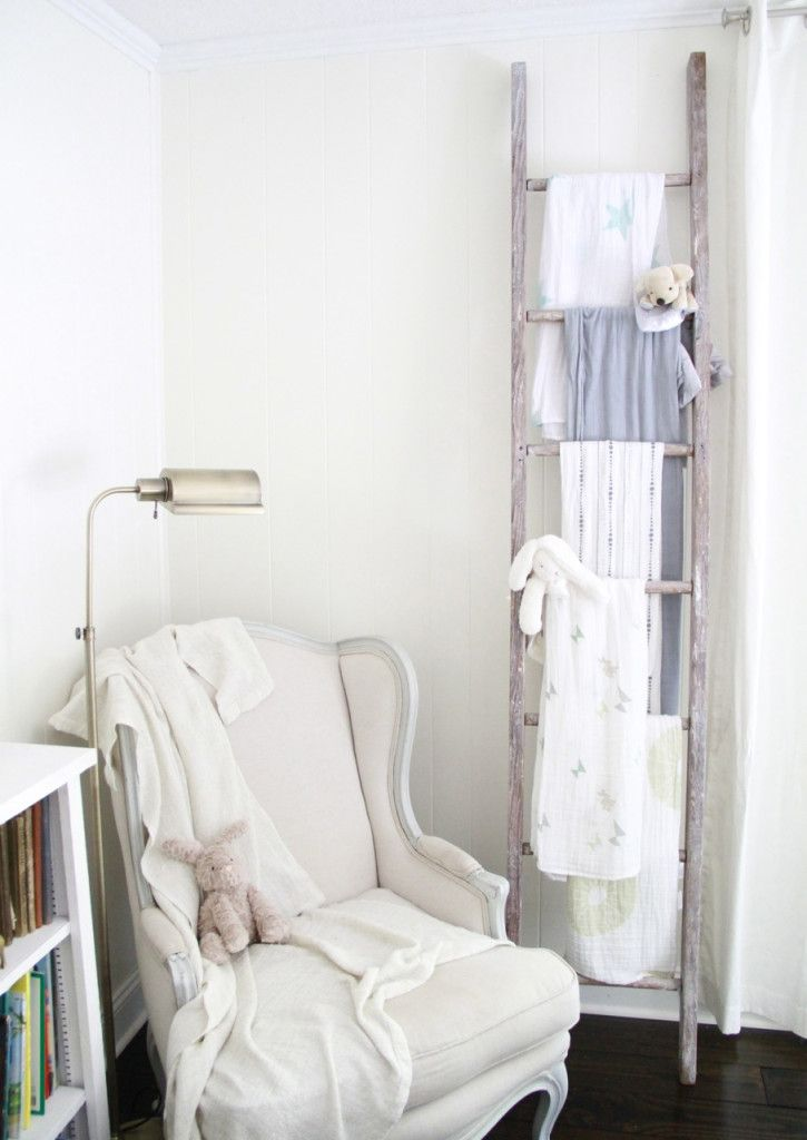 Love this vignette. The wall ladder of baby blankets and swaddles is both precious and functional!