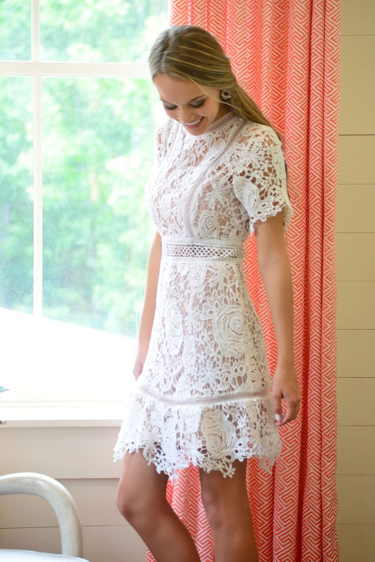 This dress could not be prettier! Bride to be's out there: it makes the perfect rehearsal dinner dress! Thick, white lace pops against the nude lining and an unlined waistband shows a tasteful peak of skin. Zipper in back.