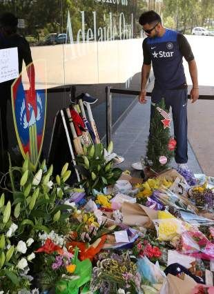 Virat Kohli puts out his bat at a tribute to Phillip Hughes at the Adelaide Oval, Adelaide, November 29, 2014