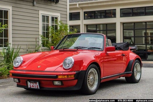1986 Porsche 911 Carrera Cabriolet - $187,995   in 1984 they began offering the M491 option on the 3.2 Carrera. It remained an option on the 3.2 from 84 to 89. The 87-89 models also have the G50 transmission just like the standard Carreras a normally aspirated Carrera minus the actual turbo. Has the stretched fenders. It included: The wide-body The turbo whale tail The turbo wrap-around chin spoiler The turbo suspension The turbo brakes with 285 mm cross-drilled disc, & the wheels.