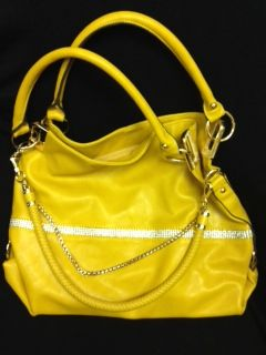 Genuine leather ladies handbag, mustard coloured with bling accessories. Retail value $85.00. Donated by Wendy Brown.