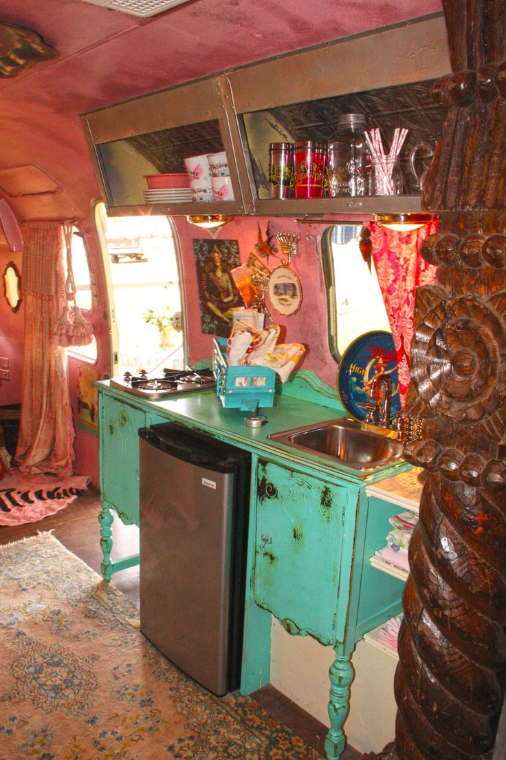 our own JuNK Gypsy airstream, amie's and indie's little love shack! designed especially for mama and daughter. . .  vintage BUFFET turned into kitchen counter!
