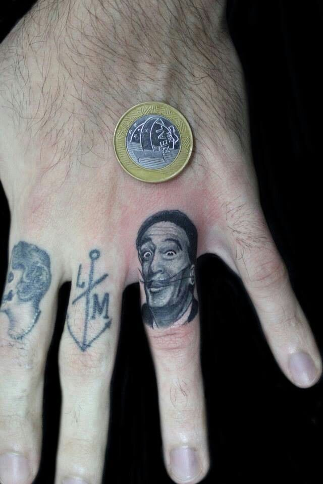 Awesome detail Salvador Dali tattoo