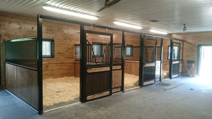 Was an empty garage, now a 3-stall stable with wash stall, hay & feed storage, tack room +
