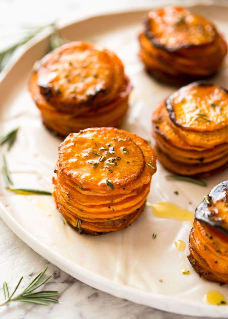 These Roasted Sweet Potato Stacks have crispy edges, are buttery, salty and sweet with a hint of rosemary. Terrific Sweet Potato side dish!