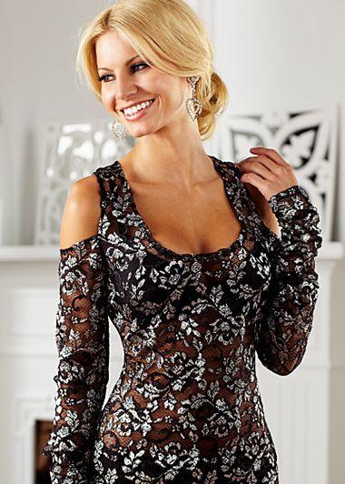 Black Multi (BKMU) Lace Cold Shoulder Top$42  Embrace lace! Cold shoulder lace top features a scalloped hemline and a scooped neckline.  ·62% Nylon, 27% mylar, 11% spandex  ·Made in USA  ·Style #Z14020