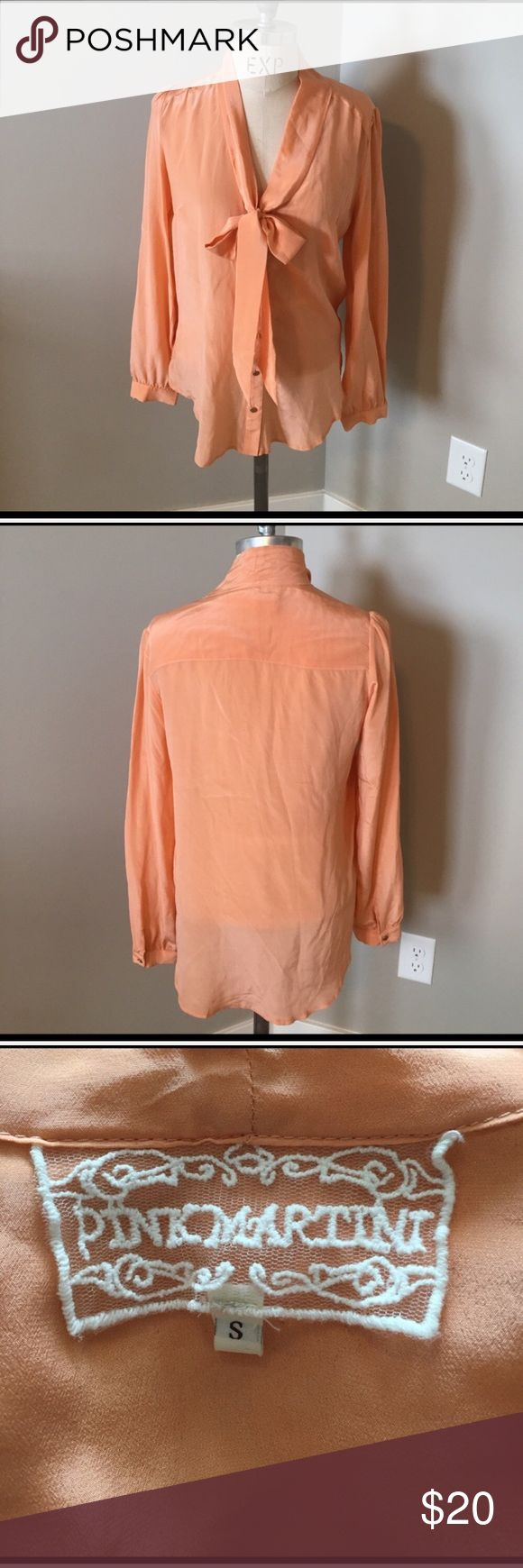 """Pink martini peach silk tie neck blouse size small 100% silk peach tie neck blouse. Gold buttons This was modeled by a fashion blogger in a fashion shoot. Size Small 20"""" from armpit to armpit laying flat. Pink Martini Tops Button Down Shirts"""