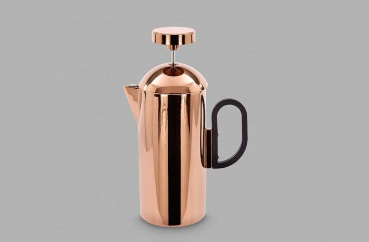 17 Contemporary Coffee Maker Designs That You'll Want To Show Off | Not only will the coffee inside this French press help wake you up, the metallic finish will also brighten your morning and make it easier to start your day.