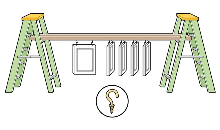 Create a DIY paint station by spanning a pair of 2x4s with hooks between two ladders to create a makeshift jig that provides access to all sides of a cabinet door.