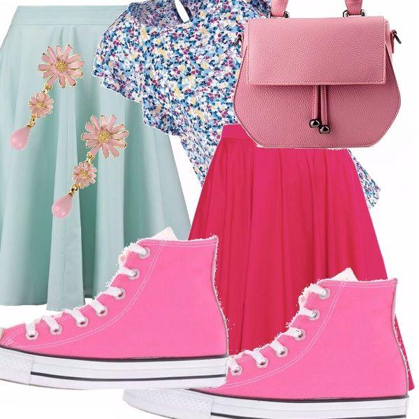 Si può scegliere se abbinare la casacchina a fiori con la gonna celeste oppure con quella rosa, indossando le Converse rosa, la borsa piccola a mano e un paio di orecchini pendenti che richiamano il motivo a fiori.