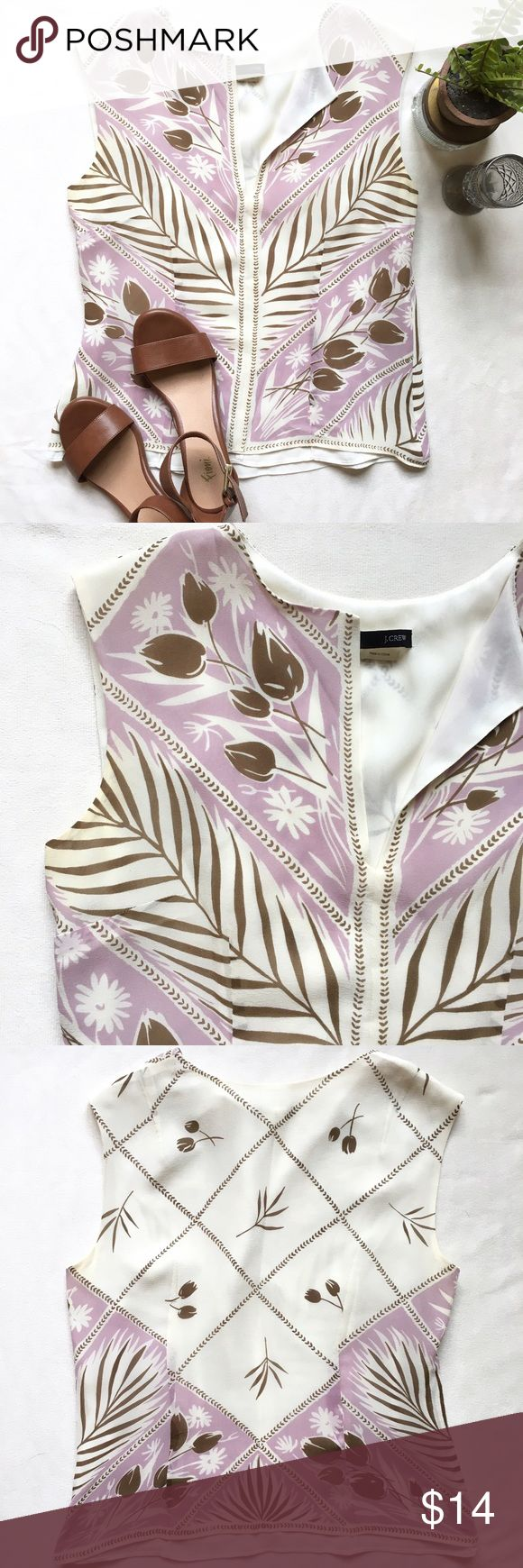 J. Crew Tank Blouse Stunning feminine floral Tank Blouse with simple lapel style neck line. Has a bit of a tropical flat with the palm branch pattern. Zip side closure. Miner discoloration on arm pit area (see photo) and small snag mid/bottom front Blouse. Otherwise in good condition! J. Crew Tops Blouses
