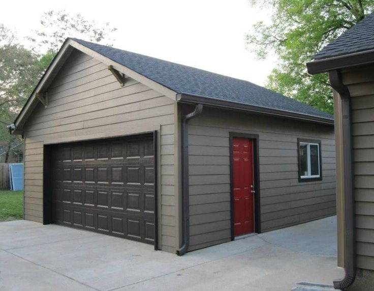 Detached 2 car garage, brown with a red side entry door