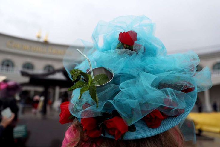 OUTRAGEOUS KENTUCKY DERBY HATS <<>> Best and Biggest <<>> A patron wearing a festive hat looks on prior to the 143rd running of the Kentucky Derby at Churchill Downs. © Patrick Smith/Getty Images