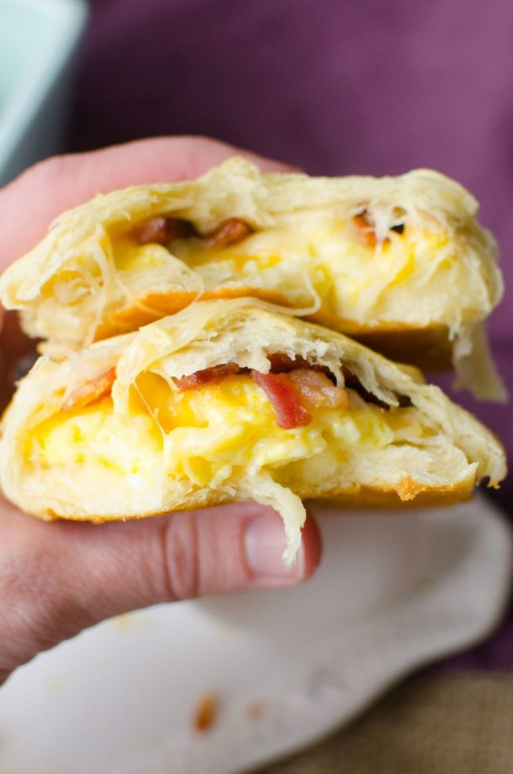 Bacon, Egg and Cheese Breakfast Pockets are full of fluffy scrambled eggs, bacon bits, and melted cheese wrapped up and baked in canned crescent roll ...