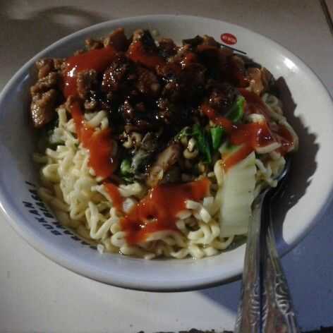 Yummyyy.. delicious lunch. Mie ayam made in Indonesian >,