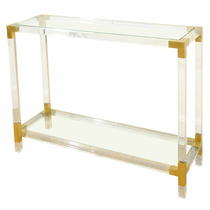 A Lucite, Glass and Brass French Console  France.  1950's.  The rectangular body made up of squared lengths of lucite held in brass fitting, supporting two glass shelves.