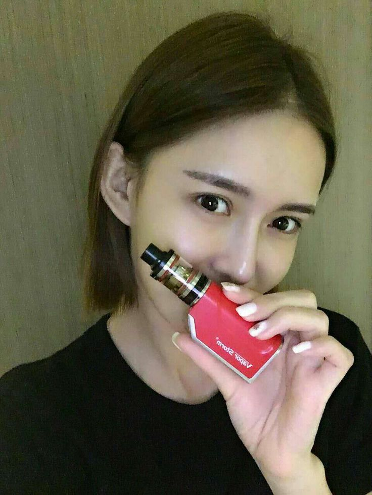 red vape device with beautiful girl.