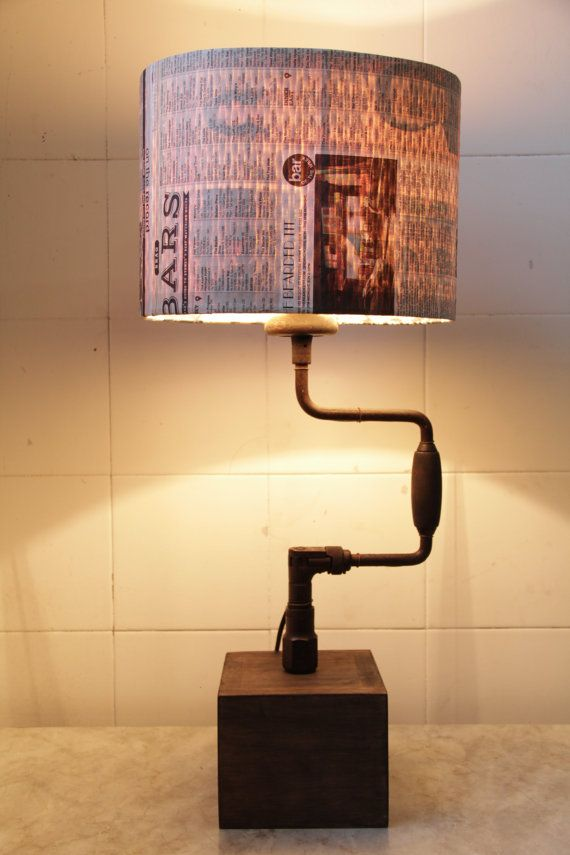 This table lamp has been created using an antique hand drill as the centerpiece. It is an excellent example of this nostalgic tool. The timber